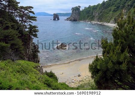 "Cape Sosnovy and cliff ""Sail"". Far Eastern Marine Reserve, Primorsky krai, Russia Royalty-Free Stock Photo #1690198912"