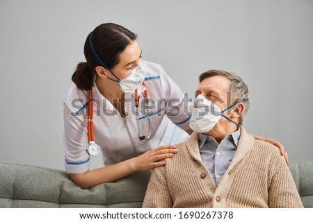 Doctor and senior man wearing facemasks during coronavirus and flu outbreak. Virus and illness protection, home quarantine. COVID-2019                                #1690267378
