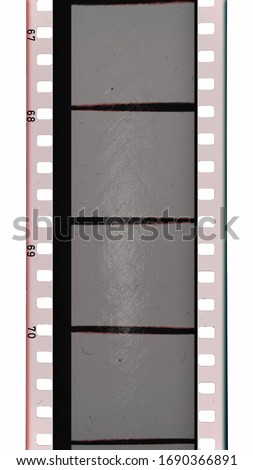 real scan of 35mm cine filmstrip with empty or blank frames, cool vintage photo placeholder on white background. #1690366891