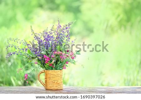 Beautiful meadow flowers bouquet. summer season, rustic garden. nature background. copy space