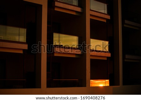 Reflection of a sunset on windows #1690408276