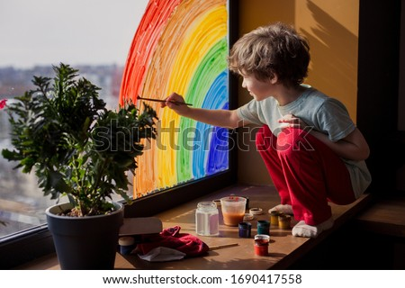 let's all be well. child at home draws a rainbow on the window. Flash mob society community on self-isolation quarantine pandemic coronavirus. Children create artist paints creativity vacation #1690417558