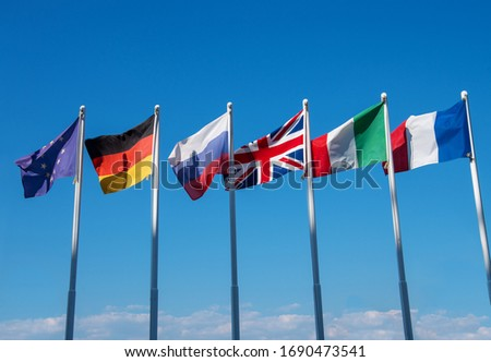 international flags against blue sky