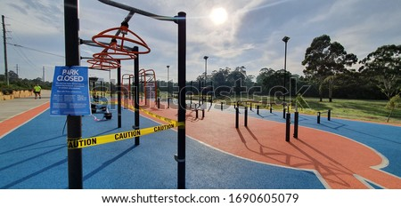Generic imagery of the closed public park sport facilities in Sydney Australia due to Covid-19 pandemic with re danger and yellow caution tapes restricting access Royalty-Free Stock Photo #1690605079