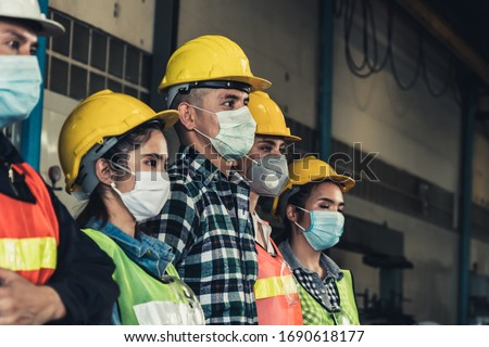 Quarantined masked workers protect spreading of Covid 19 by wearing face masks. Coronavirus Disease or COVID can spread easily without mask. Workers are advised to wear masks during quarantine time. #1690618177