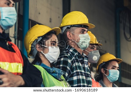 Factory workers with face mask protect from outbreak of Corona Virus Disease 2019 or COVID-19. #1690618189