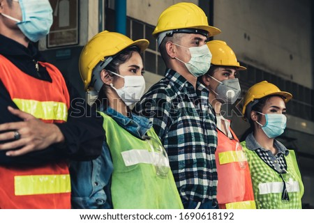 Quarantined masked workers protect spreading of Covid 19 by wearing face masks. Coronavirus Disease or COVID can spread easily without mask. Workers are advised to wear masks during quarantine time. #1690618192