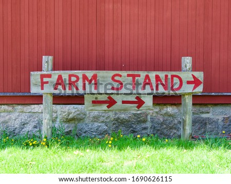 Farm stand sign and red barn in Connecticut