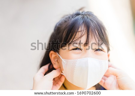Coronavirus Covid-19 and Air pollution concept.Chinese girl and chinese mother wearing mask for protect pm2.5 and virus corona Covid19 when go outside.Pandemic coronavirus and epidemic virus symptoms. #1690702600