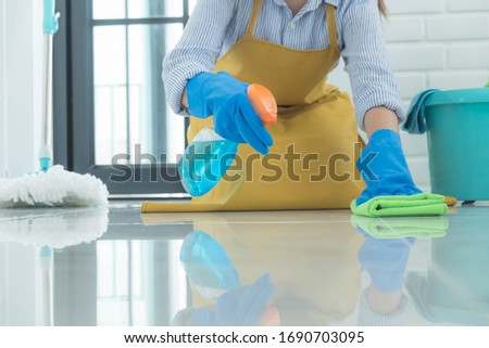 The cleaning staff use cloths on the surface and use cleaning agents containing ingredients to kill disease and viruses. #1690703095