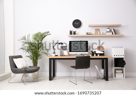 Modern computer on table in office interior. Stylish workplace Royalty-Free Stock Photo #1690735207