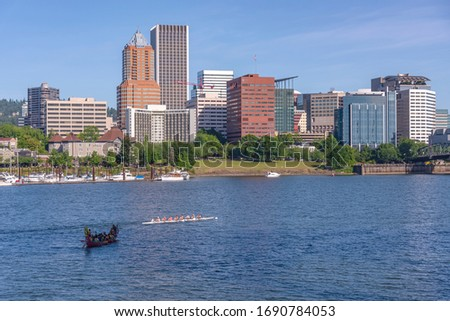 Portland Oregon skyline and rowing boats in morning light.