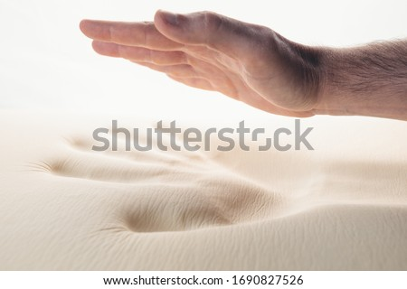Hand is pressing a memory foam bed  Royalty-Free Stock Photo #1690827526