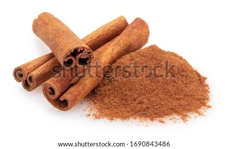 cinnamon stick with powder isolated on white background closeup Royalty-Free Stock Photo #1690843486