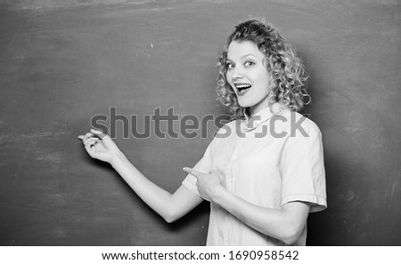 School curriculum. university or college life. student show blackboard. back to school. woman likes studying. woman teacher at school lesson. knowledge day. empty blackboard information. copy space. #1690958542