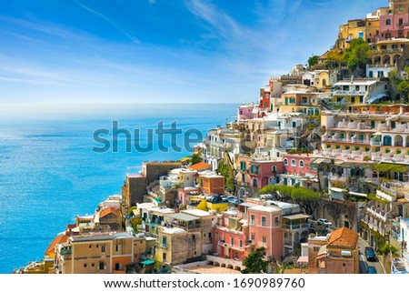 Beautiful Positano with hotels on hills leading down to coast, comfortable beaches and azure sea on Amalfi Coast in Campania, Italy. Amalfi coast is popular travel and holyday destination in Europe. Royalty-Free Stock Photo #1690989760
