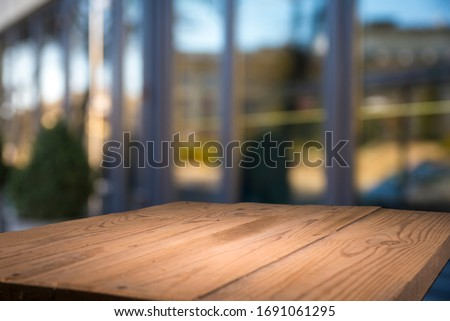 Empty tropical wood table and blurred garden cafe light background. product display template.Business presentation #1691061295