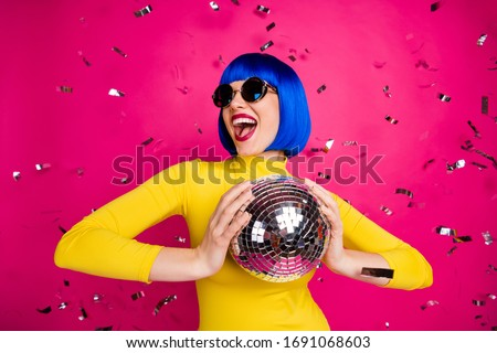 Photo of funny excited lady student party nightclub hold disco ball dancing queen confetti fall wear retro specs yellow turtleneck blue short wig isolated bright pink color background Royalty-Free Stock Photo #1691068603