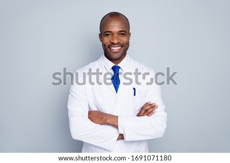 Photo of cheerful doctor dark skin guy virologist agent corona virus seminar conference arms crossed pandemic virus expert wear white lab coat tie isolated grey color background #1691071180
