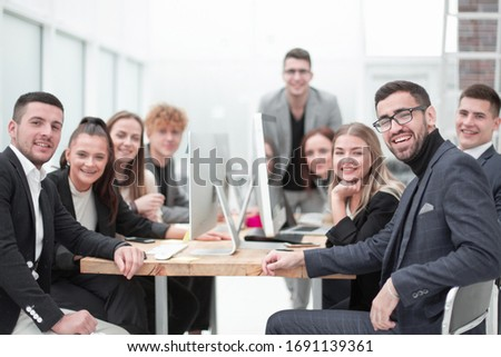 project Manager and working group sitting at a table in the conference room. #1691139361