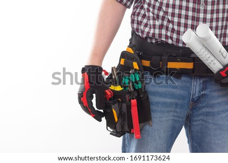 Electrician or professional Builder in an installer's belt with tools on a white background. Electrician's tools in black bags on the worker's belt. Banner with space for text Royalty-Free Stock Photo #1691173624