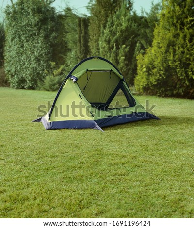 camping tent mounted on grass #1691196424