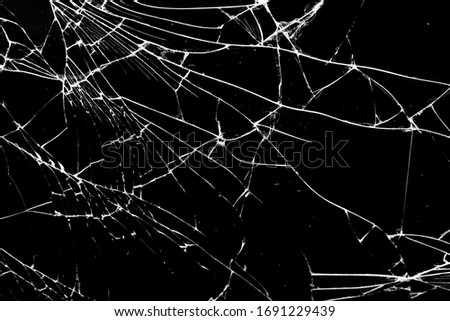 broken glass. cracks isolated on black background