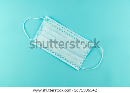 3 ply surgical face mask isolated on light blue background. #1691306542