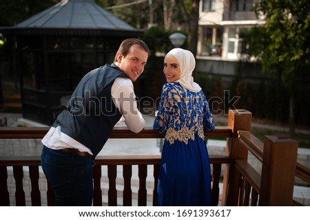 A young man with his wife in a hijab. Romantic date, happy family #1691393617