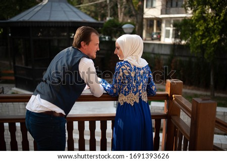A young man with his wife in a hijab. Romantic date, happy family #1691393626