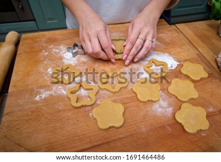 FOOD; woman making homemade biscuits on a kitchen's wooden desktop #1691464486