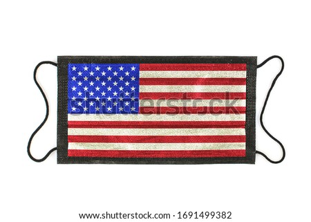 Black medical mask with picture of American Flag. Black medical mask as a symbol of mortal danger of Covid-19 in USA. Close-up protective masks textile filter. high resolution isolated on white.