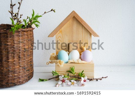 Happy Easter day. Easter decor. Painted eggs in a wooden house. Spring. Easter eggs.