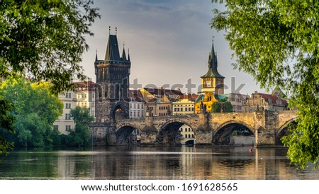 PRAGUE, CZECHIA - NOVEMBER 23, 2019: Charles bridge, view from river Vltava, Czech Republic. View of the Charles Bridge in Prague, Czech republic #1691628565