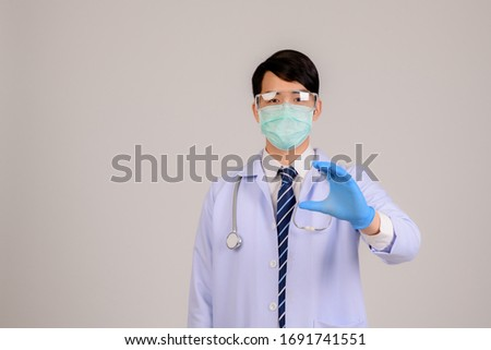 Coronary Virus and Air Pollution Concepts PM2.5 Asian doctors wear masks to protect the PM2.5 and show hand-stop gestures to stop the coronary virus outbreak. Wuhan, corona virus and the symptoms of t #1691741551