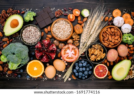Ingredients for the healthy foods selection. The concept of healthy food set up on wooden background. #1691774116