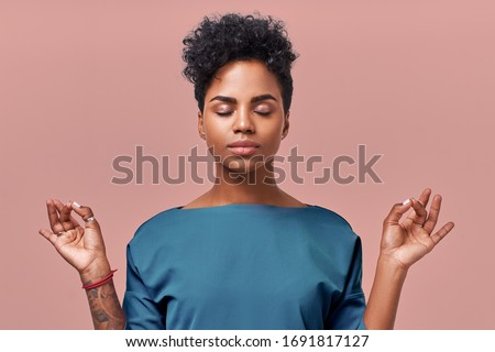 Calm woman relaxing meditating, no stress free relief at work concept, mindful peaceful young businesswoman or doctor practicing breathing yoga exercises on isolated over beige background Royalty-Free Stock Photo #1691817127