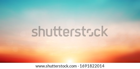 Blur pastels gradient sunset background on soft nature sunrise peaceful morning beach outdoor. heavenly mind view at a resort deck touching sunshine, sky summer clouds. #1691822014