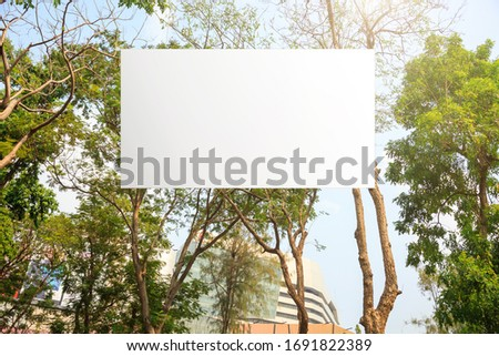 Blank advertising billboard hanging in park