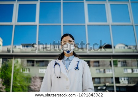 Epidemiologist in front of isolation hospital facility.Coronavirus Covid-19 heroes.Mental strength of medical professional.Emergency room doctor prepared for virus outbreak.Brave physician #1691843962