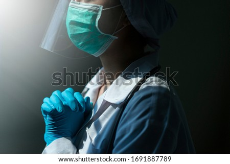 doctor in PPE suit uniform has stress and pray in Coronavirus outbreak or Covid-19, Concept of Covid-19 quarantine.Emotional stress of overworked doctor and medical care team during covid-10 period.  #1691887789