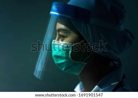 Portrait female Doctor wearing  Surgical mask and quarantine room Covid-19 (Coronavirus)Coronavirus outbreak or Covid-19, Concept of Covid-19 quarantine t #1691901547