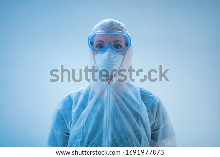 Medical doctor, scientist in full body suit for prevention from viruses and diseases. Royalty-Free Stock Photo #1691977873