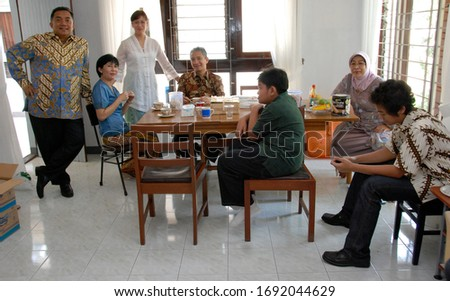 Jakarta, Indonesia - February 2020 : A family gathers up in a room in their house. #1692044629
