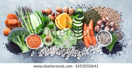 Plant based diet ingredients. Healthy food high in vitamins, antioxidants, smart carbohydrates Royalty-Free Stock Photo #1692050641