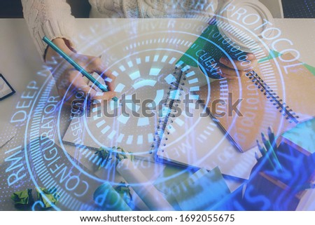Double exposure of hands making notes background with technology and digital coding huds. Data learning concept. #1692055675