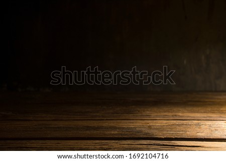 Old wood table on dark background. #1692104716