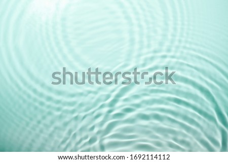 Soft focus cosmetic moisturizer water toner or emulsion green herbal extrac abstract background #1692114112