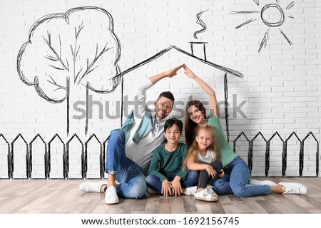 Happy family with kids dreaming about new house. Illustrations on brick wall Royalty-Free Stock Photo #1692156745