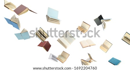 Old hardcover books flying on white background #1692204760